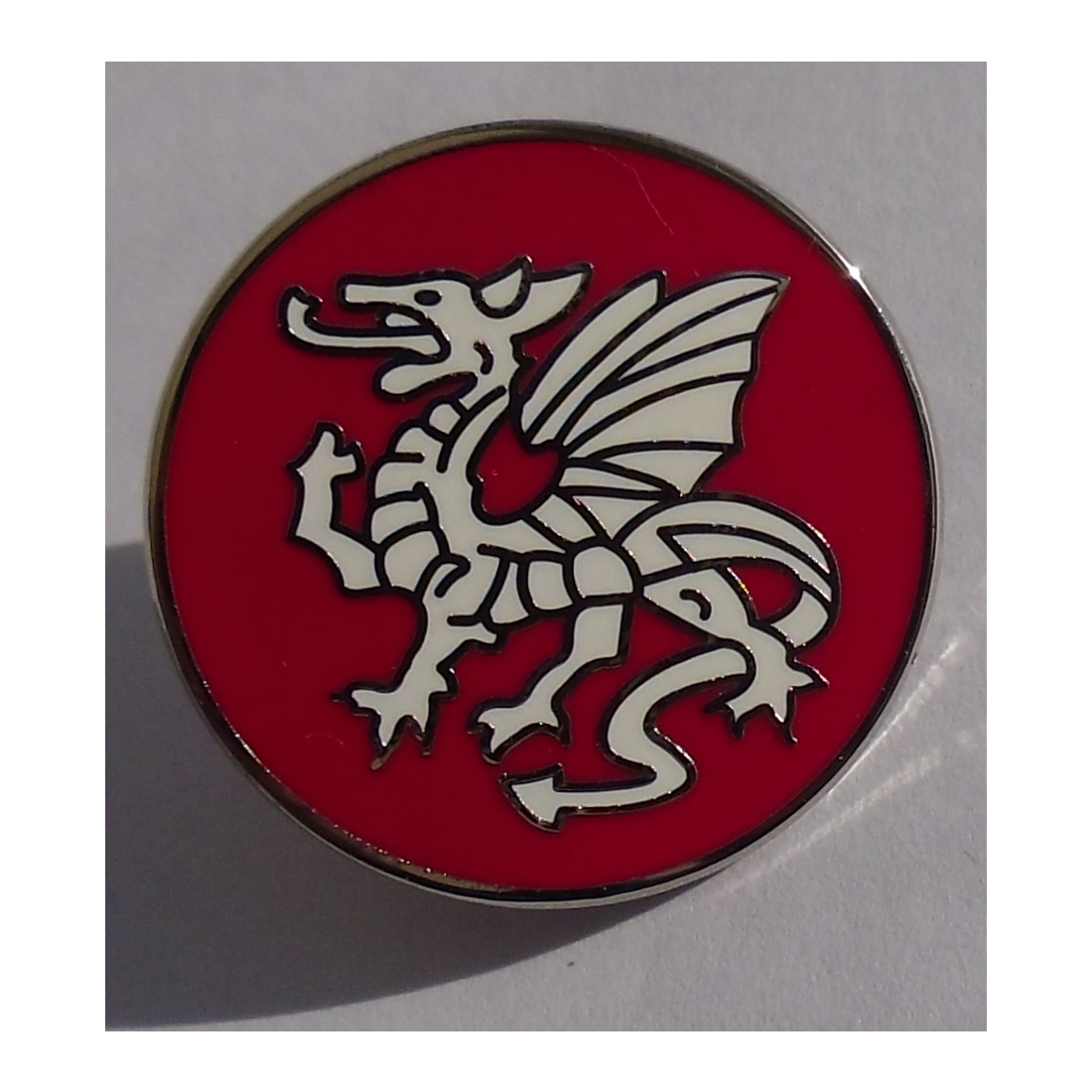 Round White dragon pin badge - Click Image to Close