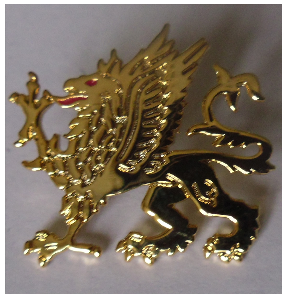 Griffin metal pin badge in gold colour metal